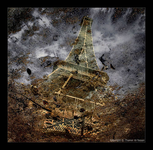 Eiffel Puddle Reflection
