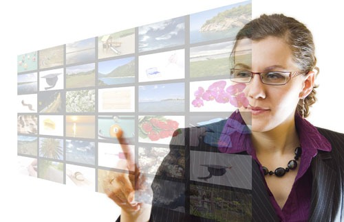 woman-pointing-multimedia-screen