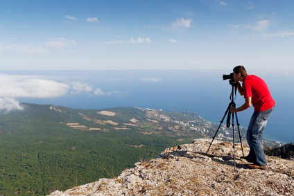 photographer with camera on mountains